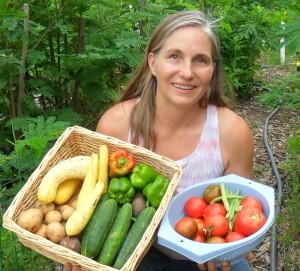 Marjory in garden holding veggies full