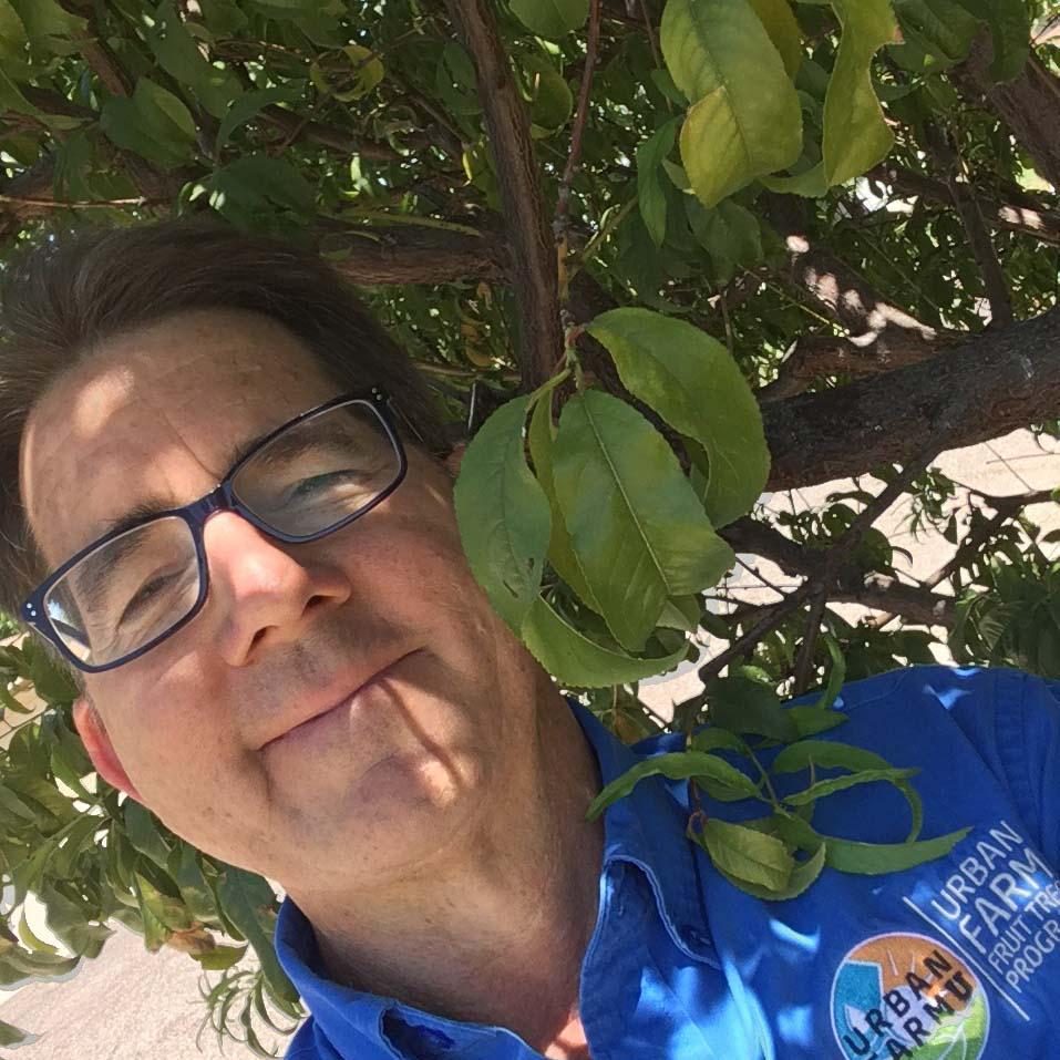 Farmer Greg under a tree